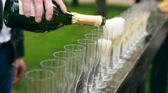Many elegant empty and half-empty wine glasses of wine or champagne on the Stock Footage