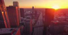 Aerial view of downtown LA skyline at sunset. Camera flying backward. 4K UHD - stock footage