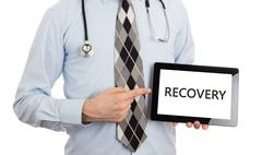 Doctor holding tablet - Recovery - stock photo