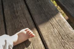 Chubby bare baby feet - stock photo