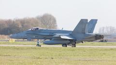 LEEUWARDEN, NETHERLANDS - APRIL 11, 2016: Finish Air Force F-18 Hornet landin Kuvituskuvat