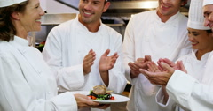 Gourmet cook applauding their colleague Stock Footage