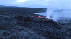 Eruption in Hawaii. Hot Lava Emerges on the Sandy Shore Down. - stock footage