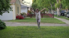 Happy girl dancing jumping waving hands running Slow motion Stock Footage