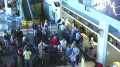 Airline passengers checking in at an Airline Counter Stock Footage
