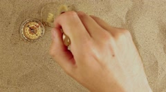 Discover vintage compass in desert sand - stock footage