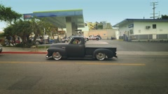 LOS ANGELES - March 2016: Young man driving lowered 1950s Chevy pickup truck Stock Footage