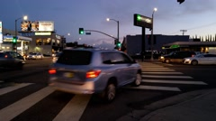Car traffic intersection La Brea Ave and Beverly Blvd at dusk in Los Angeles 4K Stock Footage