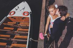 Bride and groom on the background of recreational river boats. View from above Stock Photos