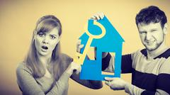 Young marriage arguing about first house buying. Stock Photos