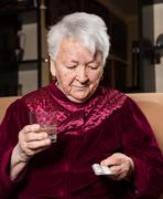 Senior woman with pills Stock Photos