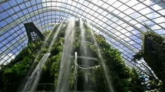 Singapore. Circa March 2016. Waterfall inside the Cloud Forest conservatory in - stock footage