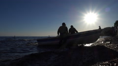 Fishermen prepare a boat for fishing Stock Footage