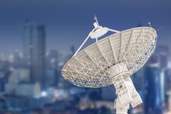 Satellite dish antenna radar and building background Stock Photos