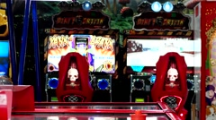 Boy with glasses playing air hockey in the amusement park with slot machines. Stock Footage