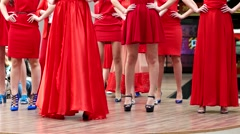 Fashion shows red color on the catwalk model show dresses on girls. - stock footage