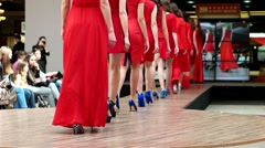 Legs of young models in red dresses at the presentation of the show clothes. Stock Footage