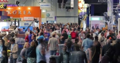 NAB 2016: Crowds of attendees on Convention Center show floor 4K timelapse - stock footage