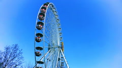 Time lapse, big wheel against the sky. Stock Footage