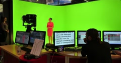 NAB 2016: Virtual production studio green screen chroma key background - stock footage