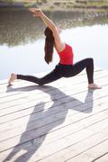 Teenage girl doing lunge posture Kuvituskuvat