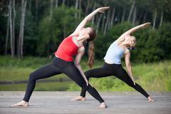 Yoga class: Reverse Warrior Pose Stock Photos