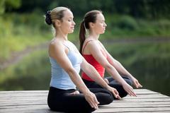 Yogi female meditating - stock photo