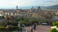 Scenic Florence from above; tourists stroll - stock footage