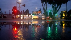 Rainy evening Melrose Avenue. Low angle view of street traffic Los Angeles 4K Stock Footage