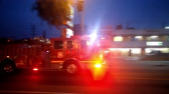 Ambulance fire truck with flashing red lights rushing street night 4K Stock Footage