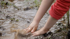 Mud pond play detail dirt - stock footage