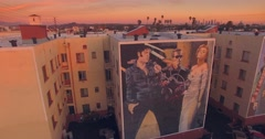 Aerial view the Beatles graffiti mural in city of Los Angeles at sunset. 4K UHD. Stock Footage