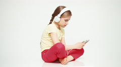Child 7-8 years using mobile phone and listening music. Thumb up. Ok Stock Footage