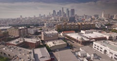 Aerial view of Arts district with downtown Los Angeles skyline in background Stock Footage