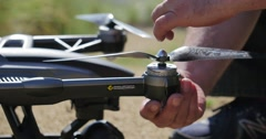 Closeup male hands attaching propellers to UAV model aircraft drone 4K UHD - stock footage