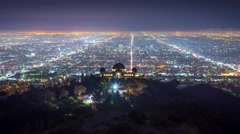 Los Angels skyline night Griffith Observatory city streets background Timelapse - stock footage