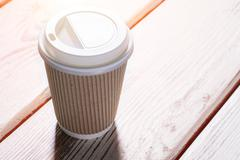 Cup with a lid. - stock photo