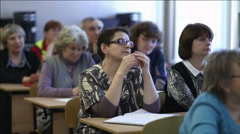 Females listen to a lecture sitting in a classroom - stock footage