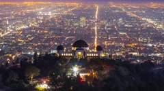 Los Angeles skyline night Griffith Observatory city streets in background 4K - stock footage