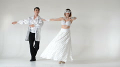 Young and stylish ballet couple dancing on white background Stock Footage