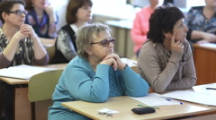 Females listen to a lecture sitting in a classroom Stock Footage