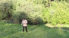 Man mowing the grass at sunset Stock Footage