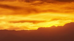 Colorful fiery sunset over mountain range. 4K UHD Timelapse. Stock Footage