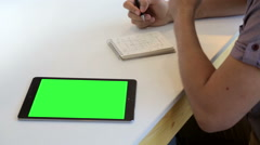 Young designer drawing web design with green screen tablet Stock Footage