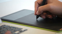 Close up of hands of a young creative individual artis using a Wacom tablet Stock Footage