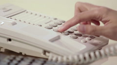 Dialing telephone - stock footage