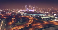 Aerial view Los Angeles freeway traffic downtown skyline at night 4K - stock footage