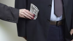 Corrupted Businessman takes a bunch of money from businesswoman, closeup Stock Footage