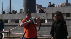 Man is shooting from AK47.Exhibition of weapons Stock Footage