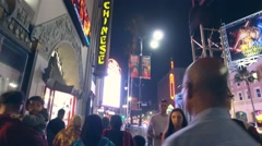 Tourist crowd walking on Hollywood Walk of Fame Boulevard at TCL Chinese Theatre - stock footage